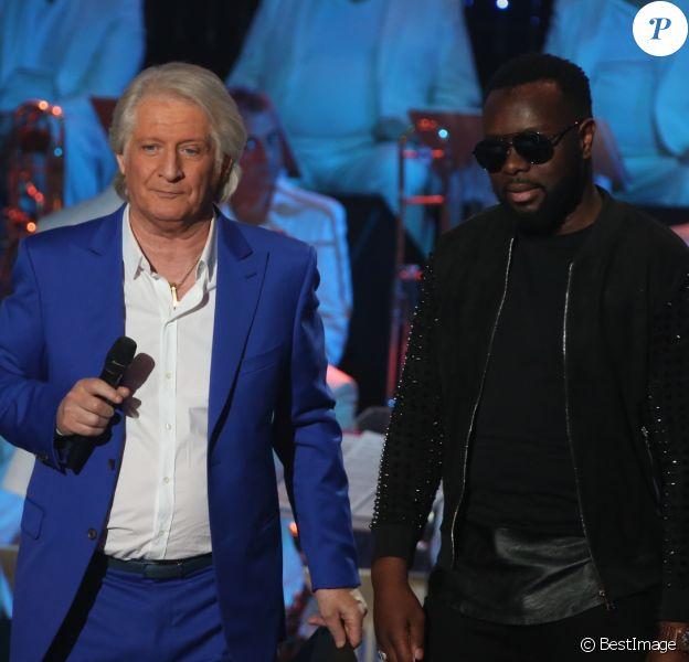 """Exclusif - Patrick Sébastien et Maitre Gims - Enregistrement de l'émission """"Les années bonheur"""", diffusée sur France 2 le 19 mai. Le 20 mars 2018 © Bahi / Bestimage"""