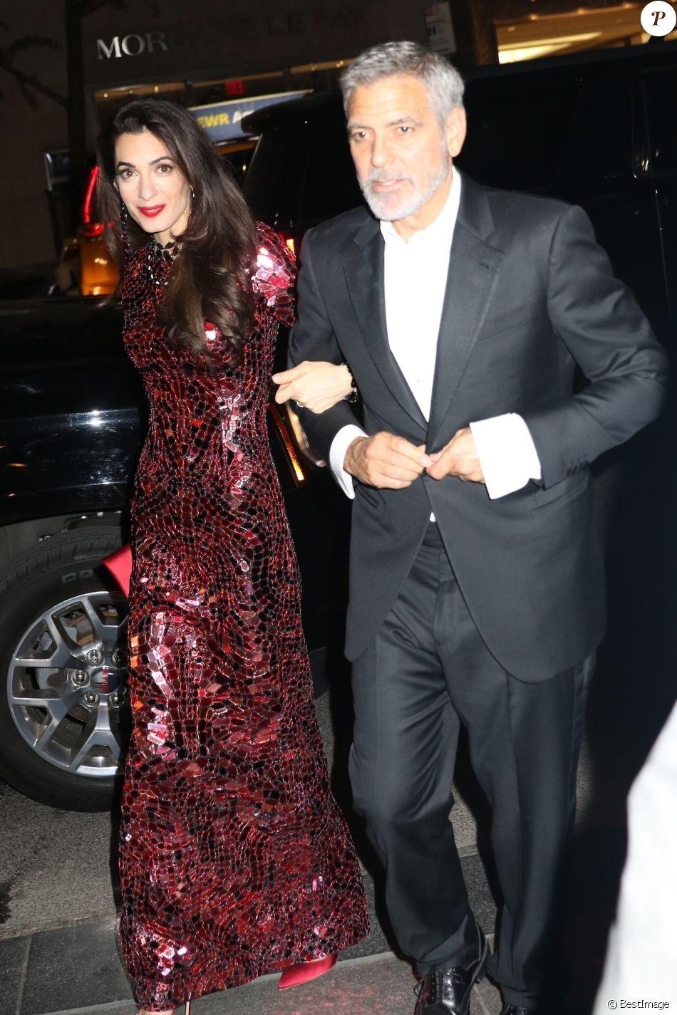 George Clooney et sa femme Amal retournent à leur hôtel après la soirée Met Gala (Met Ball, Costume Institute Benefit) à New York le 8 mai 2018.