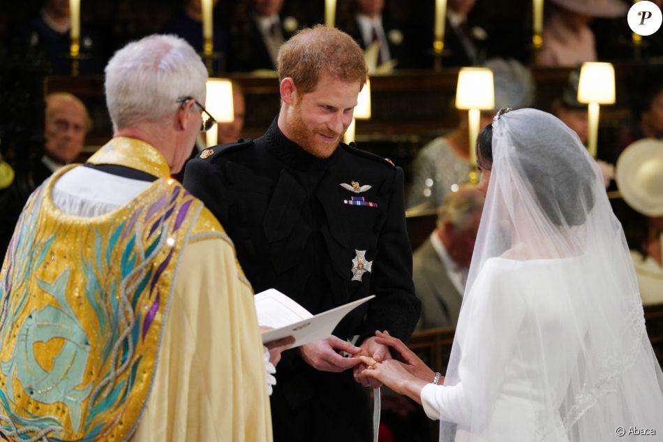 Le prince Harry et Meghan Markle, duc et duchesse de Sussex, échangeant les alliances lors de leur mariage le 19 mai 2018 en la chapelle St George à Windsor. Une cérémonie marquée notamment par leur émouvante complicité amoureuse, qui sautait aux yeux...