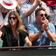 Flavie Flament et son compagnon Vladimir regardent le match entre R.Nadal et R. Gasquet ainsi que son ex mari Benjamin Castaldi avec sa femme Aurore Aleman dans les tribunes des Internationaux de France de Tennis de Roland-Garros à Paris le 2 juin 2018.