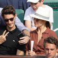 Jalil Lespert, Pierre Niney et sa compagne Natasha Andrews dans les tribunes des Internationaux de France de Tennis de Roland Garros à Paris, le 10 juin 2018. © Dominique Jacovides - Cyril Moreau/Bestimage