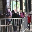 Les enfants d'immigrants retenus a la frontière mexicaine arrivent au Cayuga Center a New York, le 22 juin 2018.