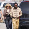Les Black Eyed Peas, sans Fergie, sur le tournage de leur nouveau clip à Los Angeles, le 19 avril 2009. Will.I.Am en tenue de combat aux côtés d'une belle inconnue...