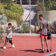 Exclusif - Cristiano Ronaldo dispute une partie de tennis avec son fils Cristiano Ronaldo Jr lors de ses vacances à Costa Navarino en Grèce le 13 juillet 2018.