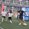 (180719) -- BEIJING, July 19, 2018 (Xinhua) -- Portuguese football player Cristiano Ronaldo plays football with students as he attends a promotional event in Beijing, China, on July 19, 2018. Photo by Xinhua/Cao Can/Newscom/ABACAPRESS.COM19/07/2018 - Beijing