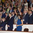 Le prince Harry et Meghan Markle (robe Jason Wu), duc et duchesse de Sussex, pendant l'hymne national lors du gala de charité The Royal Armouries' 100 Days to Peace au Central Hall Westminster à Londres le 6 septembre 2018, une soirée musicale commémorant le centenaire des cent derniers jours de la Première Guerre mondiale.