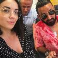 """Cyril Hanouna présente son nouveau look lors de la signature du contrat d'Agathe Auproux pour """"Touche pas à mon poste"""" (C8) le 3 juillet 2018."""