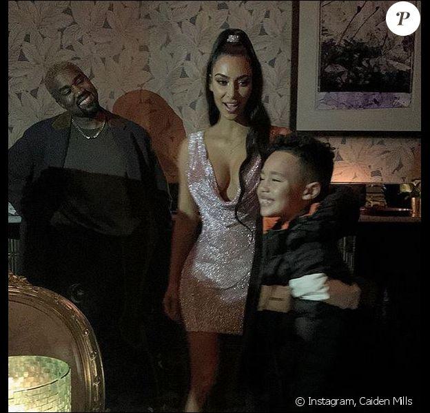 Kanye West, Kim Kardashian et le fils du rappeur Consequence, Caiden Mills. Décembre 2018.