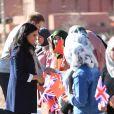 Le prince Harry, duc de Sussex et Meghan Markle (enceinte), duchesse de Sussex en visite dans un pensionnat à Asli lors de leur voyage officiel au Maroc. Le 24 février 2019