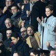 Camille Combal, Nasser Al-Khelaïfi, Président-Directeur général du PSG, Ophelie Meunier et son mari Mathieu Vergne dans les tribunes du parc des Princes lors du match de football de ligue 1, opposant le Paris Saint-Germain (PSG) contre l'Olympique de Marseille (OM) à Paris, France, le 17 mars 2019. Le PSG a gagné 3-1.