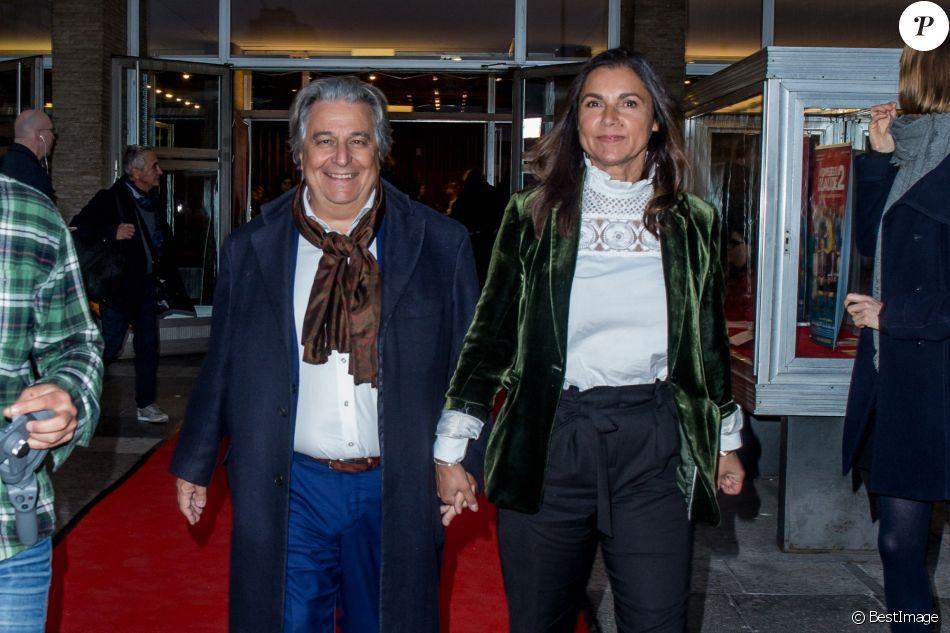 """Christian Clavier et sa compagne Isabelle de Araujo lors de la première du film """"Monsieur Claude 2"""" (Qu'est-ce qu'on a fait au Bon Dieu 2) à Berlin en Allemagne le 2 avril 2019."""