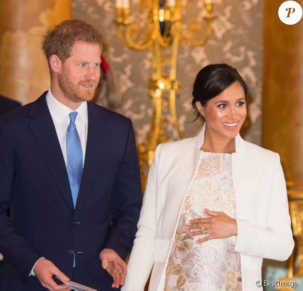 Le prince Harry, duc de Sussex, et Meghan Markle (enceinte), duchesse de Sussex - La famille royale d'Angleterre lors de la réception pour les 50 ans de l'investiture du prince de Galles au palais Buckingham à Londres. Le 5 mars 2019