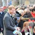 Le prince Harry, duc de Sussex et Meghan Markle (enceinte), duchesse de Sussex en visite à Birkenhead le 14 janvier 2019.