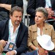 Henri Leconte et Maria Dowlatshahi dans les tribunes de Roland-Garros à Paris, le 29 mai 2019. © Jacovides-Moreau/Bestimage