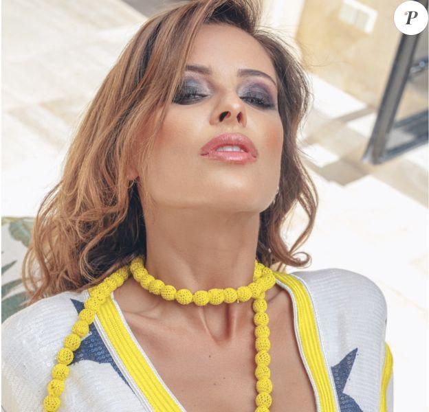 """La belle Malika Ménard présente sa collction capsule """"8"""" en collaboration avec la marque marocaine Linebleu, juillet 2019."""