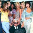 Karen Mulder, Carla Bruni, Nadja Auermann, Naomi Campbell, Linda Evangelista, Claudia Schiffer, Helena Christensen et Karl Lagerfeld à Paris. Octobre 1994.