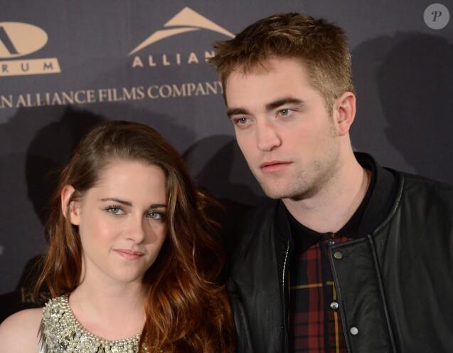 "Kristen Stewart et Robert Pattinson - Photocall du film ""Twilight Saga: Breaking Dawn"" a l'hotel Villamagna a Madrid. Le 15 novembre 2012"