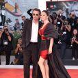 """Jean-Michel Jarre et sa compagne Gong Li Jarre à la première du film """"Saturday Fiction (Lan xin da ju yuan)"""" lors de la cérémonie d'ouverture du 76e festival du film de Venise, la Mostra, sur le Lido de Venise, Italie, le 4 septembre 2019."""