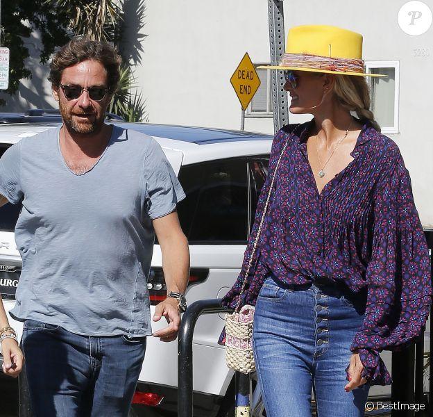 Laeticia Hallyday et son compagnon Pascal Balland ressortent d'un restaurant de sushi à Los Angeles, avant d'aller chercher leurs filles à l'école. Le 13 septembre 2019