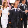 Carla Bruni lors du défilé du 14 juillet 2009 accompagnant son époux Nicolas Sarkozy