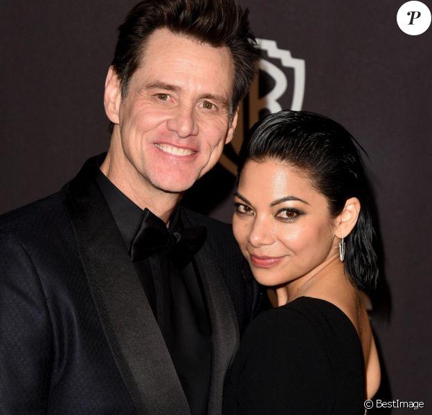 "Jim Carrey et sa compagne Ginger Gonzaga - Photocall de la soirée ""Warner InStyle Golden Globes After Party"" au Beverly Hilton Hotel à Beverly Hills. Le 6 janvier 2019"