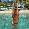 Emilie Picch topless à la plage en Guadeloupe, le 3 janvier 2020