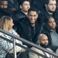 Tony Yoka et sa femme Estelle Mossely (enceinte de son deuxième enfant) de nouveau ensemble dans les tribunes lors du match de Ligue 1 opposant le Paris Saint-Germain à l'AS Monaco au Parc des Princes à Paris, France, le 12 janvier 2020. Le PSG fait match nul face à l'AS Monaco (3-3).