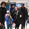 Madonna, son nouveau compagnon Ahlamalik Williams et ses enfants arrivent à l'aéroport JFK à New York, le 27 décembre 2019.