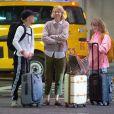 Exclusif - Naomi Watts arrive avec ses enfants Sasha et Samuel à l'aéroport de JFK à New York pour prendre l'avion, le 8 mars 2020