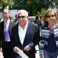 Dominique Strauss Kahn et Myriam L'Aouffir aux Internationaux de France de tennis de Roland Garros le 30 mai 2015.