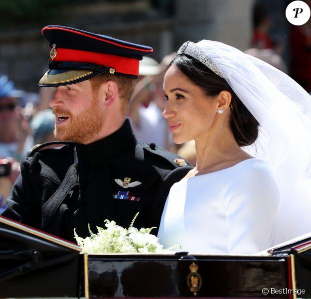 Le prince Harry, duc de Sussex, et Meghan Markle, duchesse de Sussex, en calèche au château de Windsor après la cérémonie de leur mariage au château de Windsor, Royaume Uni, le 19 mai 2018.