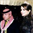 Au bras de son époux Adbullah, Rania est resplendissante.