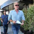Dolph Lundgren se balade au volant de sa AC Cobra dans le quartier de Beverly Hills à Los Angeles, le 29 août 2019