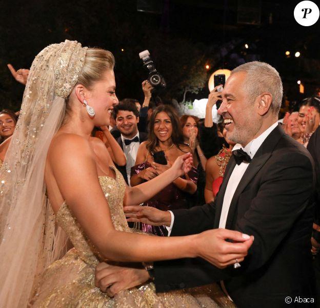Elie Saab et sa belle-fille Christina Mourad lors du mariage d'Elie Saab Jr et Christina à Faqra. Le 19 juillet 2019.