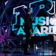 Angèle et Nikos à la 22e édition des NRJ Music Awards à la Seine musicale, le 5 décembre 2020.