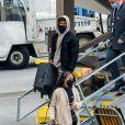 Exclusif - Michael B. Jordan et sa compagne Lori Harvey débarquent à l'aéroport de Salt Lake City le 30 décembre 2020.