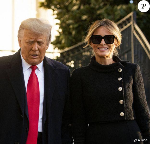 Melania et Donald Trump quittent la Maison Blanche après un mandat de quatre ans, avant d'embarquer en hélicoptère pour la base St-Andrew, le 20 janvier 2021. @Al Drago / Pool via CNP