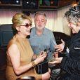 """Catherine Deneuve et Jean-Yves Bouvier sur le tournage des """"Liaisons Dangereuses"""" avec Josée Dayan, en 2002."""