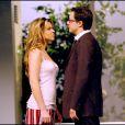 Sophie Tapie et Davy Sardou dans Oscar