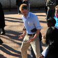 """Réunis pour la première fois en """"mission"""" à l'étranger, les princes Harry et William de Galles étaient jeudi 17 juin 2010 en visite au Lesotho. Ils ont multiplié les jeux avec des enfants atteints du VIH."""