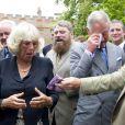 Clarence House, le 10 septembre 2010 : le prince Charles et Camilla Parker Bowles piquent un fou rire mémorable devant les 16 chats d'un orgue très spécial !
