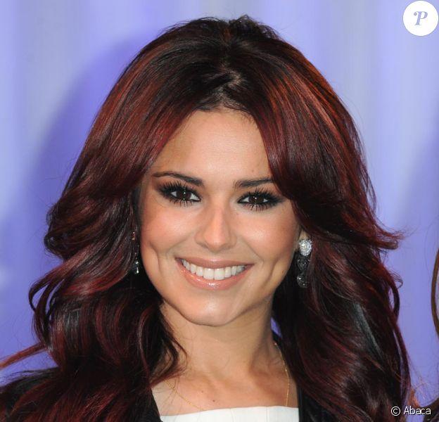 Cheryl Cole pose avec son double de cire chez Madame Tussauds à Londres le 19/10/10