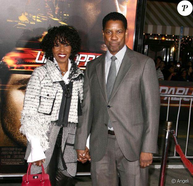 Denzel Washington et sa femme, à l'occasion de l'avant-première de Unstoppable, au Regency Village Theatre de Westwood, à Los Angeles, le 26 octobre 2010.