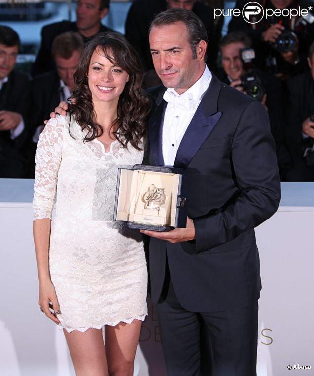 Jean Dujardin et Bérénice Bejo lors de la séance photo post-palmarès du festival de Cannes le 22 mai 2011
