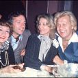Michou, Jean-Pierre Cassel et Lauren Bacall, à Paris, le 10 novembre 1975.