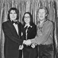 Michou, Serge Lama et Nana Moukouri, à Paris, le 24 décembre 1977.