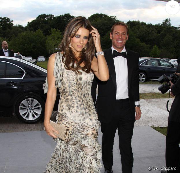 Elizabeth Hurley et Shane Warne au gala caritatif de Tiar et Tiara d'Elton John, le 23 juin à Londres.