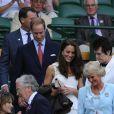 Toujours aussi complices et radieux, le prince William et sa femme Kate Middleton ont fait un détour par le court central de Wimbledon, le 27 juin 2011, avant d'embarquer pour leur visite officielle en Amérique du Nord. Juste le temps de voir Andy Murray se qualifier pour les quarts de finale.