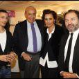 Inès de la Fressange et Denis Olivennes posent à côté de Pierre Bénichou et Steevy Boulay lors de la soirée Europe 1 fait Bobino, le 28 novembre 2011 à Bobino