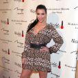 Kim Kardashian à l'occasion de l'inauguration de la boutique Kardashian Khaos à Las Vegas le 15 décembre 2011